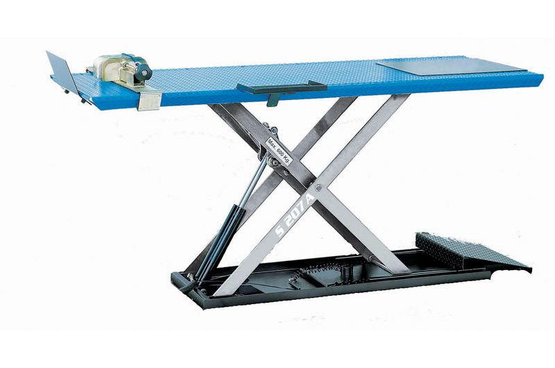Hydraulic scissor lift developed for the professionals of 2 - 3 - 4 wheelers.